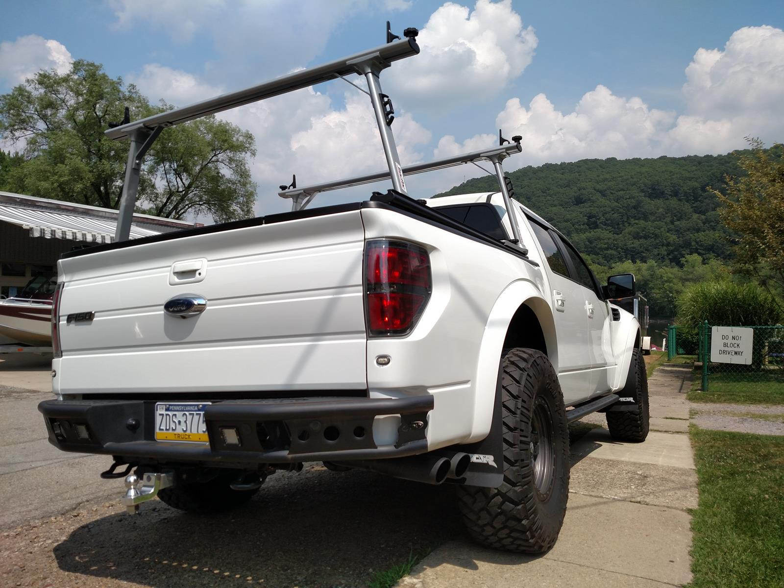 Retrax Tonneau Cover >> RevolverX4 Hard Rolling Tonneau Cover + Thule TracRac SR Truck Bed Rack System